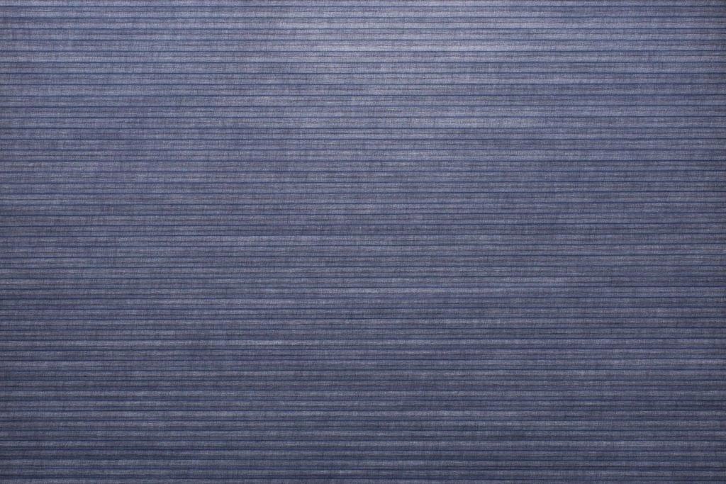 Duette® tekstilet Elan 294077-2334-5 - Bildet er tatt med lys i bakgrunnen (dag).