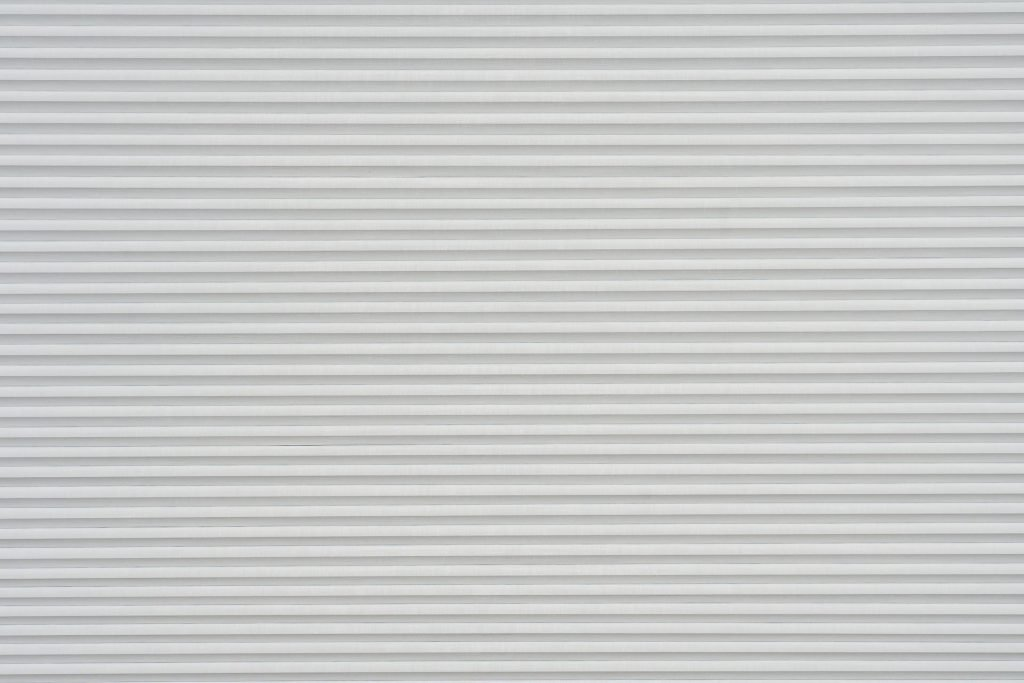Duette® serien Elan BO 294632-0000-5. Bildet er tatt med lys forfra. Tekstilet er lystett.