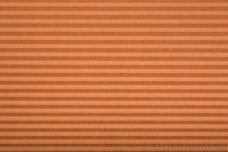 Plisségardin tekstil serien Trends 290260-5375 Orange farge. Bildet er tatt med lys forfra.