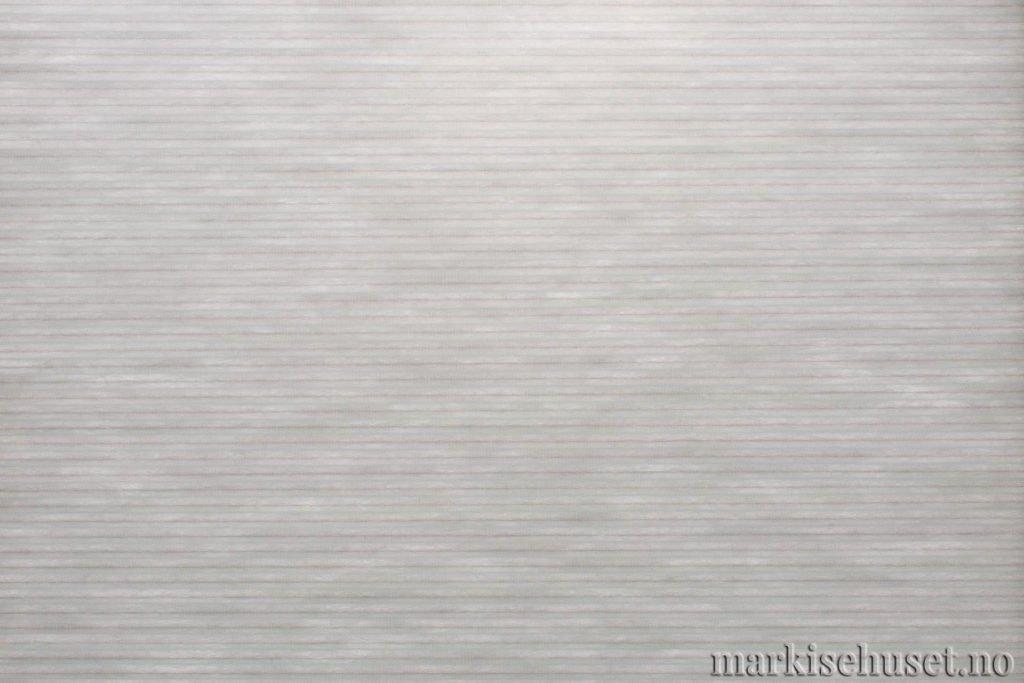 """Duette tekstil i serien Duotone 25mm. Farge: """"TeleGrey"""". Bildet er tatt med lys bakfra."""