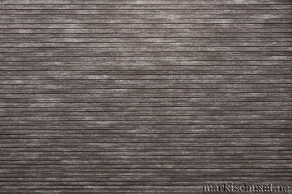 """Duette tekstil i serien Duotone 25mm. Farge: """"Charcoal"""". Bildet er tatt med lys bakfra."""