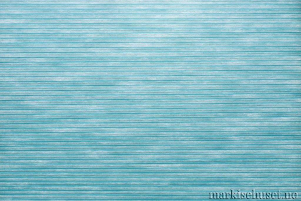 """Duette tekstil i serien Duotone 25mm. Farge: """"BrightAqua"""". Bildet er tatt med lys bakfra."""