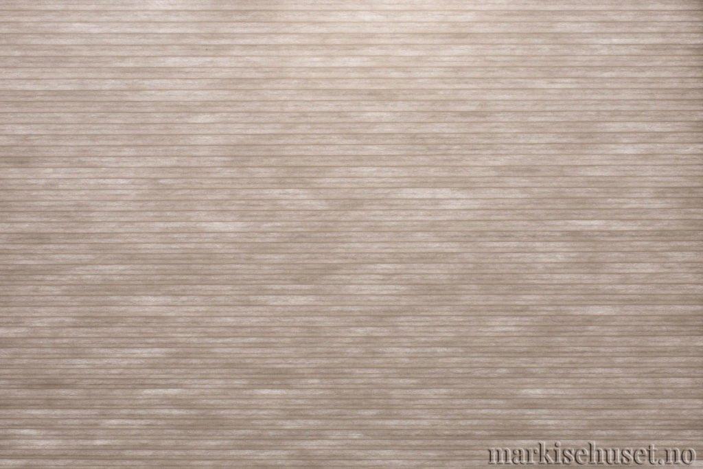 """Duette tekstil i serien Duotone 25mm. Farge: """"Coffeegray"""". Bildet er tatt med lys bakfra."""