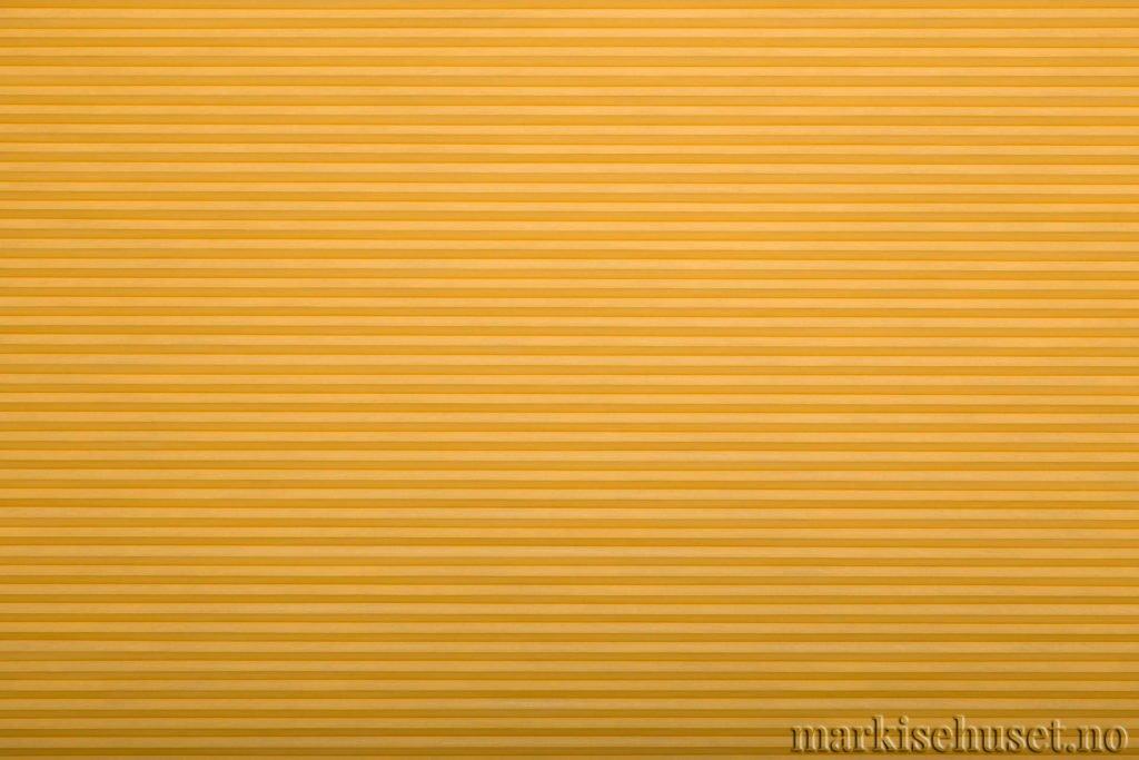 """Duette tekstil i serien Duotone 25mm. Farge: """"ProvincialGold"""". Bildet er tatt med lys forfra."""