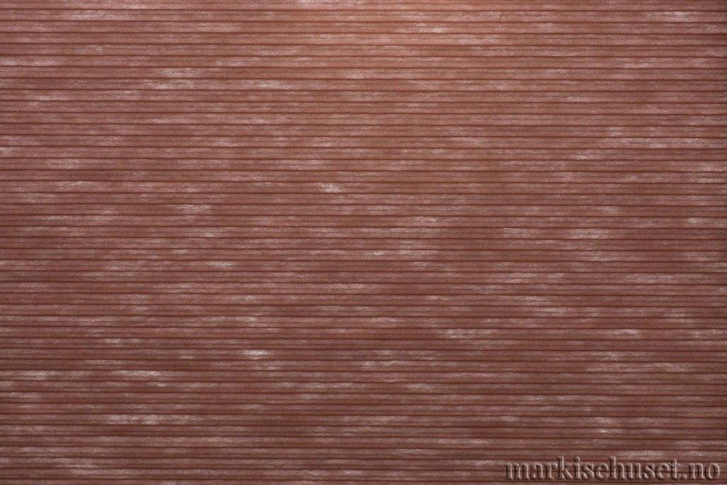 """Duette tekstil i serien Duotone 25mm. Farge: """"Foxfire Brown"""". Bildet er tatt med lys bakfra."""